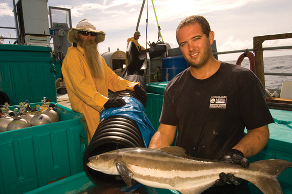 Brian O'Hanlon, President, Founder, and Board Member of Open Blue Sea Farms, holds a Cobia (Rachycentron candum) from Snapperfarm open ocean aquaculture, Culebra, Puerto Rico.