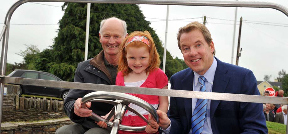 Bill Ford pictured with some Irish Fords, Henry Dan Ford and Hannah Ford O'Brien, 5, who turned out to meet him when he visited Ballinascarty, Co. Cork, birthplace of his great-great-grandfather William Ford.