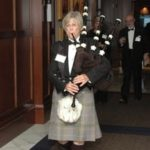 An Irish bagpiper leads the 2011 honorees into the ballroom