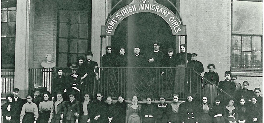 Immigrant women post in front of mission house