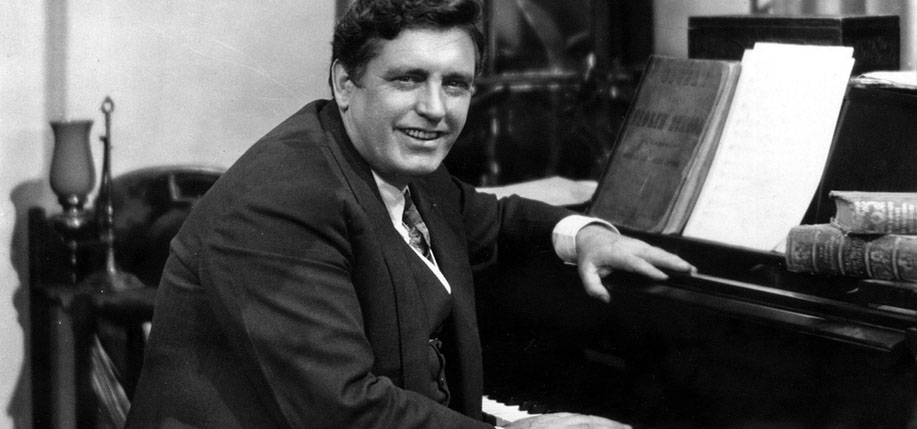 John McCormack pictured by his piano