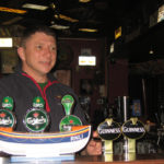 Sean Brendan O&#039;Conchuir behind the bar at Tigh TP&#039;s. Photo by Mary Tolan.