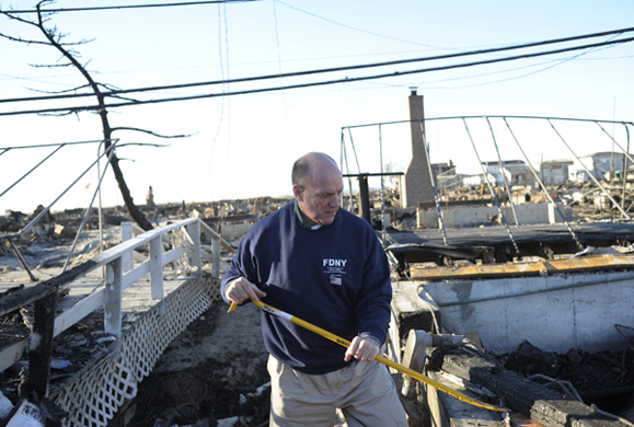 A resident of Breezy Point Queens looks over what was once his home after Hurricane Sandy, and a fire that erupted at the height of the storm, destroyed over 100 homes in New York. Photo: Peter Foley.