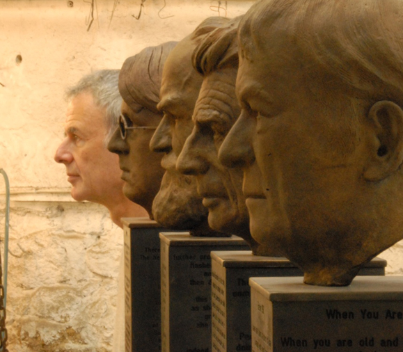 "Artist Rowan Gillespie with his sculpture, ""The Four Irish Nobel Laureates,"" John J. Burns Library. Photo: Roger Kohn."