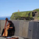 A harpist at the Cliffs of Moher.