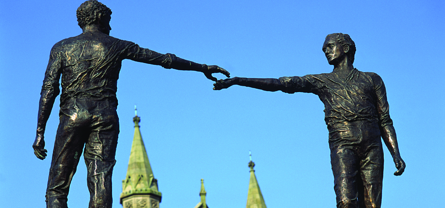 Maurice Harmon's Hands Across the Divide statue in Derry. Photo: Tourism Ireland