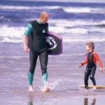 Enjoying the surf on the beach at Bundoran. Courtesy of Tourism Ireland.
