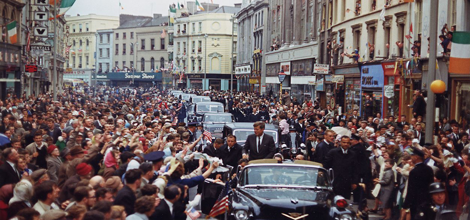 President Kennedy's motorcade drives through Cork during his 1963 trip to Ireland.