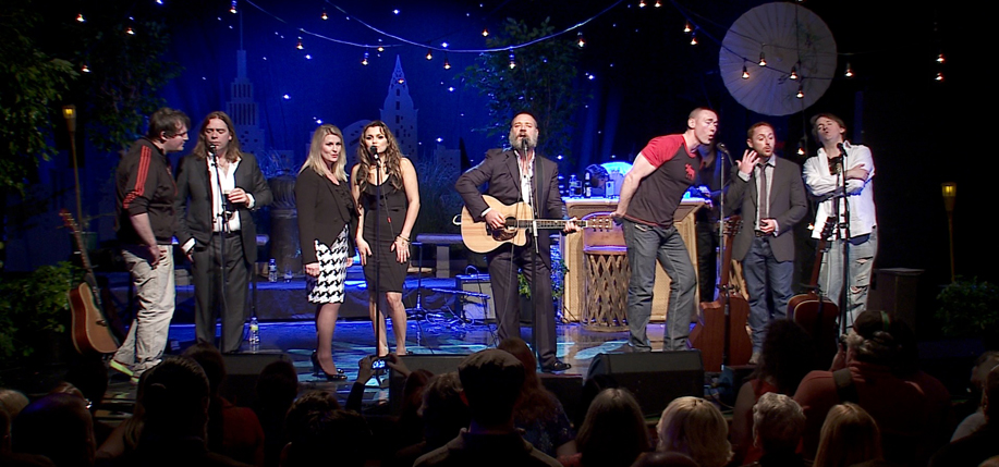 The Merry Men and guest performers at the Indoor Garden Party in New York, October 2012. L-R: Moley O'Suilleabhain, Alan Doyle, Roberta Duchak, Samantha Barks, Russell Crowe, Kevin Durand, Scott Grimes, Owen O'Suilleabhain.
