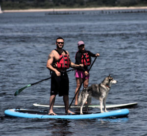 Lyndon Villone, with his dog Ice, paddle boarding in Jamaica Bay. Photo: Legends of Valor.