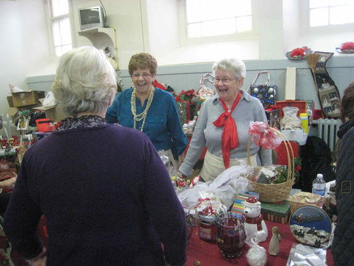 The annual Christmas Bazaar at St. Gabriel's Church. Katie Deegan is pictured on the left and her friend Pat Schell, with the red bow, is on the right. The Bazaar raised $15,000.