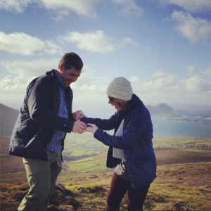 Tim and Liz after the proposal on the top of Cruach Mhárthain on the Dingle Peninsula.
