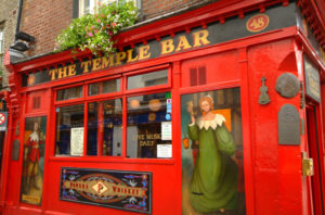 The Temple Bar Pubfront in close up with artwork of medieval characters.