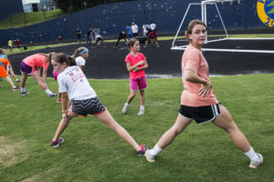 (L-R) Maeve Murray, Coco Murray and Meghan Murray warm up before a one-mile run at Bethesda-Chevy Chase High School on Wednesday, July 23, 2014 in Chevy Chase, MD. (Photo by Yue Wu/The Washington Post)