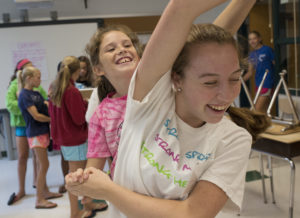 (R-L) Girls Up Teen Board member Liza Johnston (front) plays with Maeve Murray during the break at Girls Up summer camp on Wednesday, July 23, 2014 in Chevy Chase. (Photo by Yue Wu/The Washington Post)