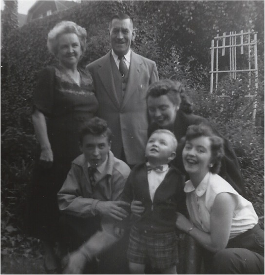 LEFT: Mary and John O'Connor with their daughters Josephine and Helen, their son John and Josephine's first son, Mary's first grandchild, Richard Reilly, at the O'Connor family home at 92 St. Marks Place, Park Slope, Brooklyn in 1953.