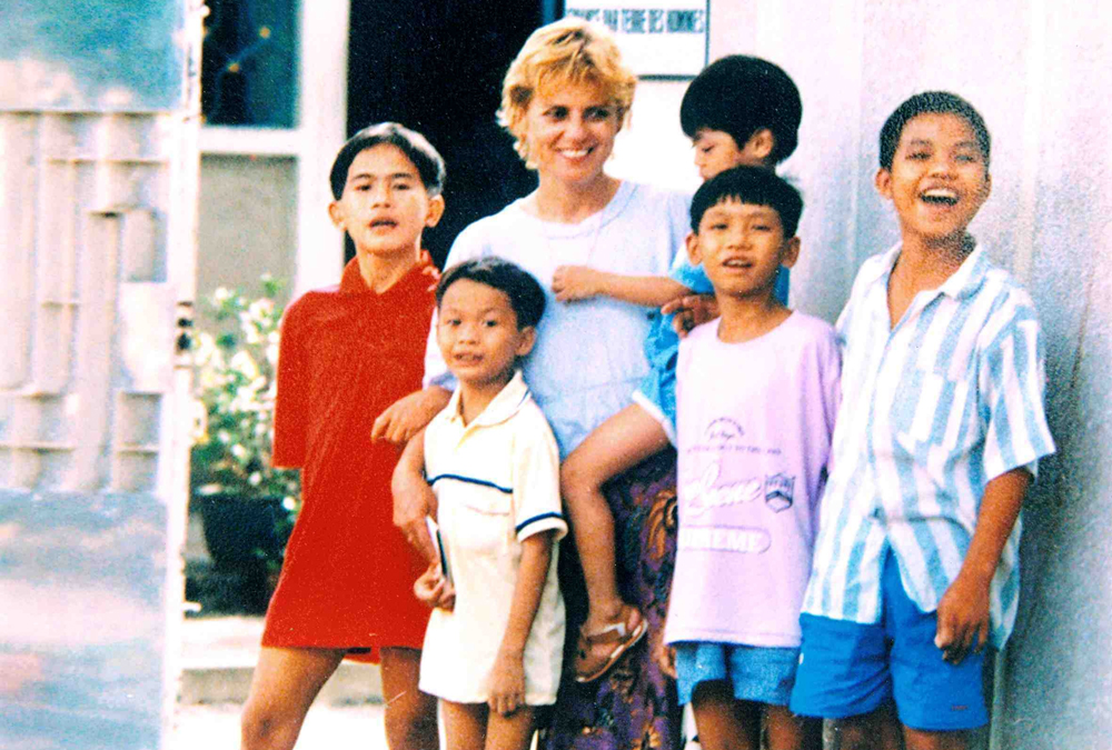 Christina Noble in Vietnam with some of the children in her care in an undated photograph.