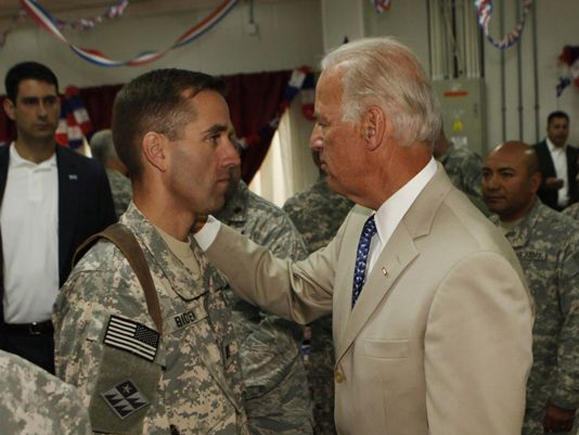 Vice President Joe Biden, right, talks with his son Beau Biden, left, an Army captain at the time, at Camp Victory on July 4, 2009, in Iraq. (Photo: Khalid Mohammed/AFP)
