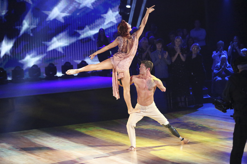 On Dancing with the Stars Noah holds his partner Sharna Burgess aloft. (Photo courtesy ABC's Dancing with the Stars)