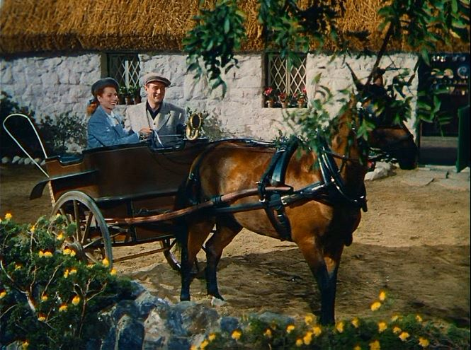 """John Wayne and Maureen O'Hara in front of the cottage in """"The Quiet Man."""""""