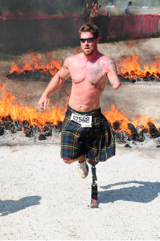 Noah Galloway taking part in an extreme race called Tough  Mudders, in  which ultimate  fitness athletes compete over tough obstacles that include fire, mud and water. (Photo courtesy Noah Galloway)