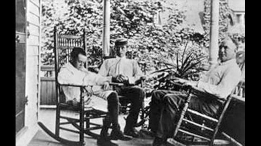 Eugene O'Neill, his brother Jamie, and his father James on the porch of Monte Cristo Cottage in New London, their summer home.