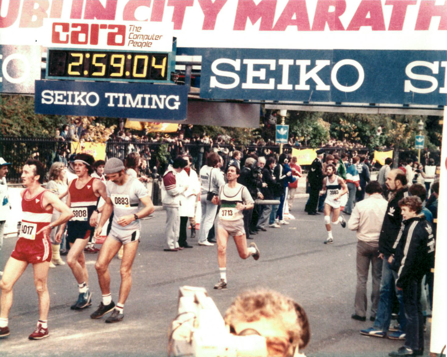 Clerkin (center, #3713) at the finish line of the 1983 Dublin Marathon. He finished with a sub-three-hour time after four friendly bets.