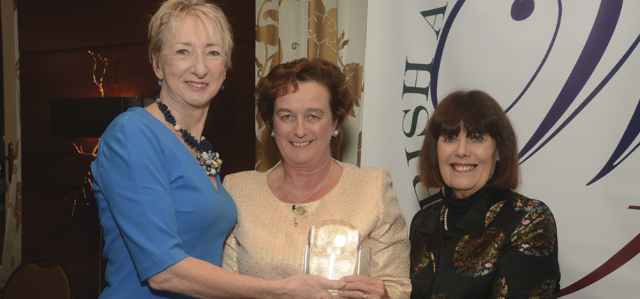 Patricia Harty, co-founder and editor-in-chief of Irish America, receives the Eugene O'Neill Lifetime Achievement Award from Ireland's Consul  General of New York  Barbara Jones and IAW&A Vice President Mary Pat Kelly.