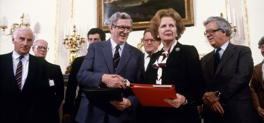 Garret Fitzgerald and Margaret Thatcher shake hands after signing the Anglo-Irish Agreement at Hillsborough.