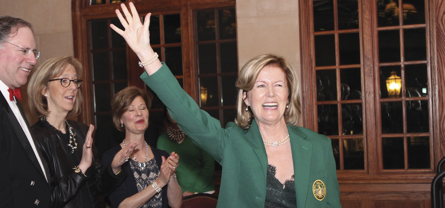 Ambassador Anne  Anderson in the green jacket of the Friendly Sons of St. Patrick after she became the first woman admitted to  the organization in its history.