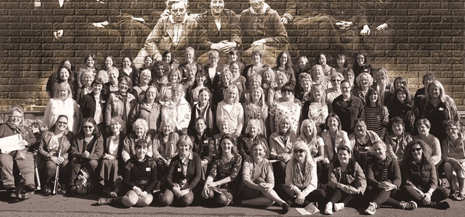 Members of the Yarn School in front of a portrait of the women held at Richmond Barracks in Dublin after the Rising.