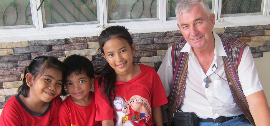 Father Shay Cullen with some of the Preda School children.