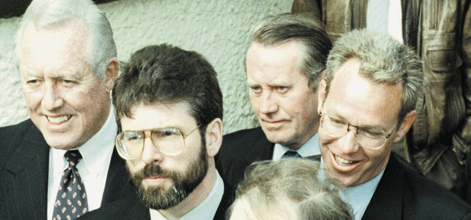 Feeney, top center, with Gerry Adams (left) and Bruce Morrison (bottom) in Northern Ireland during peace negotiations, December 17, 1997. (Photo: Crispin Rodwell)