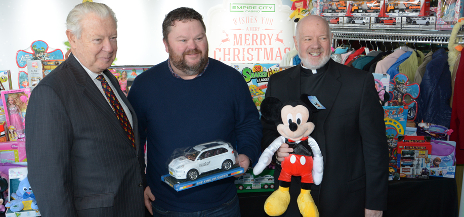 Left to right: Empire City CEO Tim Rooney, California toy donor Josh Blake, and Monsignor Kevin Sullivan. (Photo courtesy Empire City Casino)