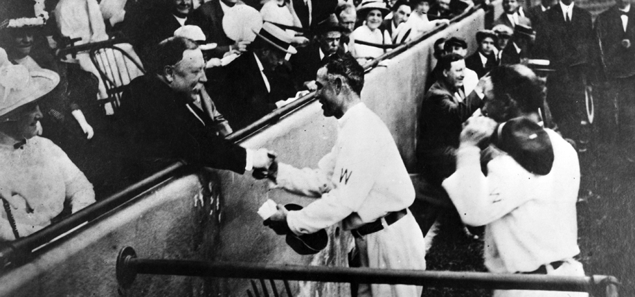 President Taft receiving baseball fromClark Griffiths after throwing out first pitch in 1910. (Photo: National Baseball Hall of Fame Library)