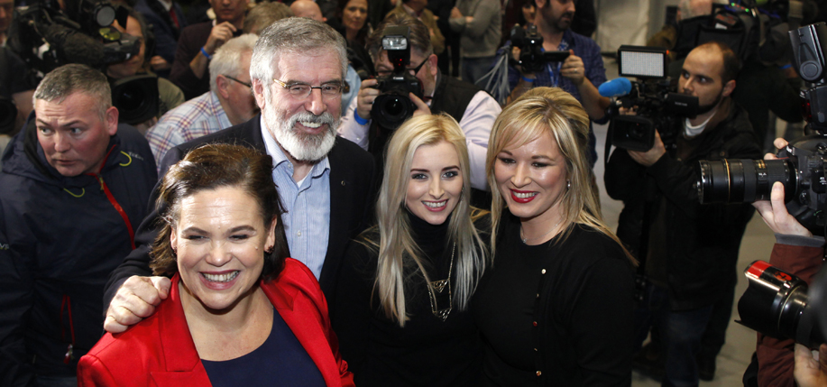 Sinn Féin's Michelle O'Neill (right) is  congratulated by party leader Gerry Adams and party members Mary Lou McDonald (left), and Órlaithí Flynn, in Belfast March 3, after Sinn Féin's victories had become clear. (Photo: Peter Morrison / AP)