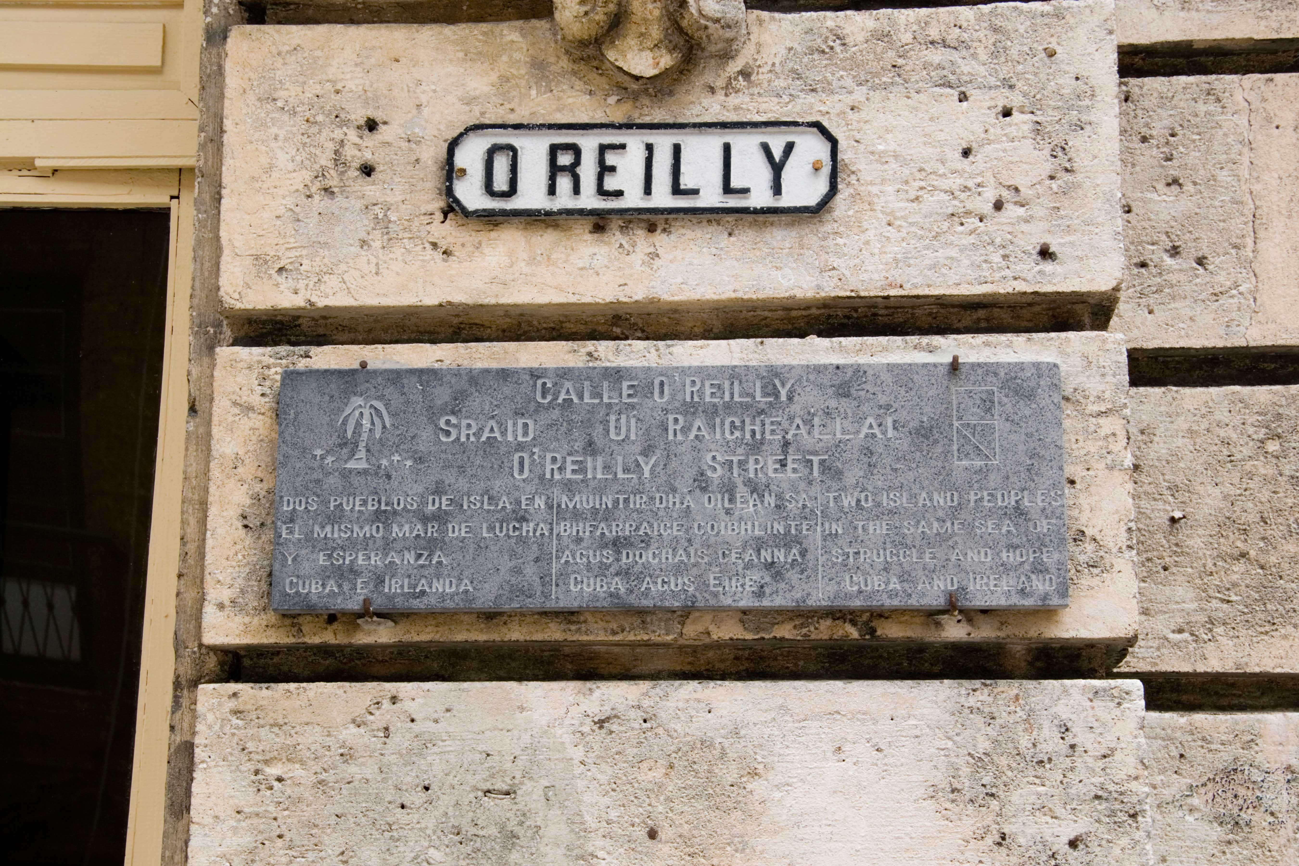 Calle O'Reilly, one of Havana's main streets. The sign, in Spanish, English, and Irish, links Cuba's struggle with Ireland's.