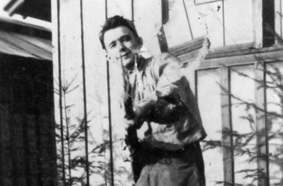 Peter Thompson poses with a rifle and bayonet. (Photo: Missoulian)