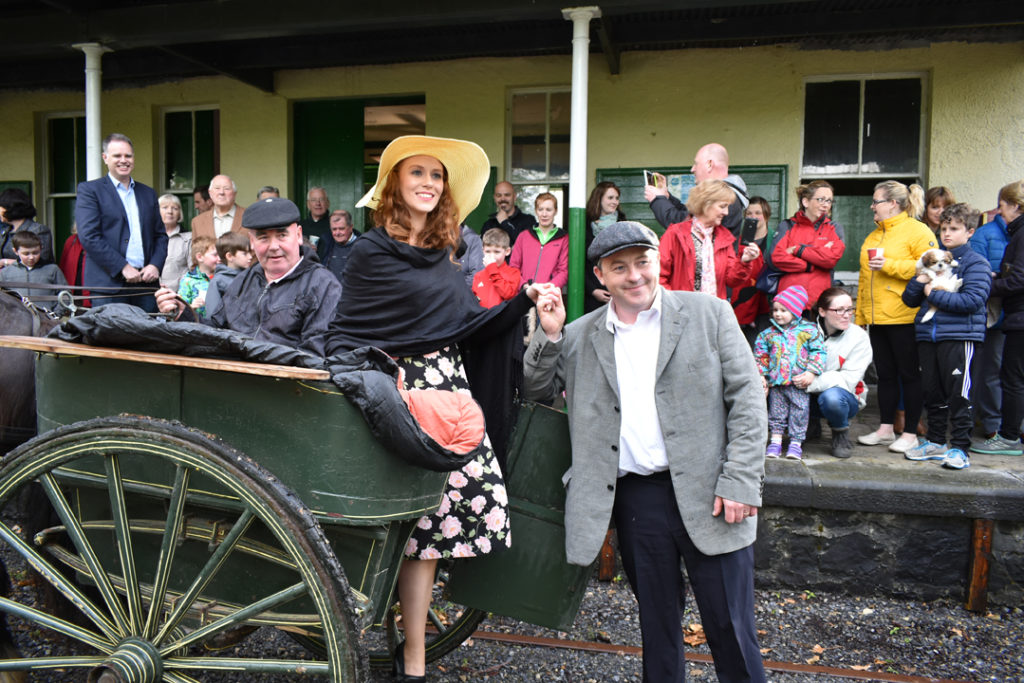Mary Kate Danagher (Eva Eagleton) and Seán Thornton (Ros na Rún star Denis O'Connor) arrive at Castletown station for the launch of the crowd funding campaign. (Photo: Ballyglunin Railway Restoration Project / Facebook)