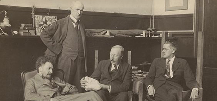 John Quinn, standing, was one of the foremost voices in support of modernist expression and is responsible for the publication of Ulysses in the United States. Pictured here with (left to right) Ezra Pound, Ford Madox Ford, and James Joyce at Pound's house in Paris in the fall of 1923.