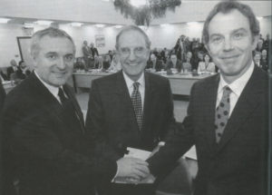 Irish Taoiseach Bertie Ahern, talks chairman George Mitchell and British Prime Minister Tony Blair shake hands after the peace deal was struck on Good Friday in Belfast.
