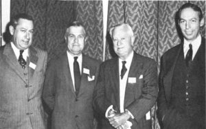 A fleet of Morans at the helm of Moran Towing and Transportation Company in the 1940s. From left: Eugene F. Moran, Jr., vice president in charge of contracts; Real admiral Edmond J. Moran, U.S.N.R., president; Eugene F. Moran, Sr., chairman of the board; Joseph H. Moran II, vice president in charge of operations.