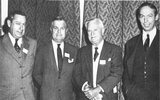 <em>A fleet of Morans at the helm of Moran Towing and Transportation Company in the 1940s. From left: Eugene F. Moran, Jr., vice president in charge of contracts; Real admiral Edmond J. Moran, U.S.N.R., president; Eugene F. Moran, Sr., chairman of the board; Joseph H. Moran II, vice president in charge of operations.</em>
