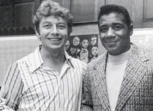 Pete and boxing champion Floyd Patterson at a party in Hamill's house in Park Slope, Brooklyn.