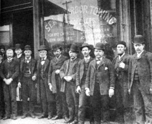 Michael Moran (holding cigar, fourth from the left), with his associates on South Street, then known as the Street of Ships.