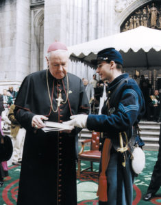 During the St. Patrick's Day Parade, Robert Carter presents Cardinal Egan with Memoirs of Chaplain Life by Father William Corby, a chaplain of the original Irish Brigade.