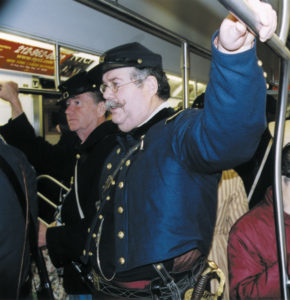 Irish Brigade reenactors take the Lexington Avenue subway from the 69th Regiment Armory on 26th Street to the midtown area where the St. Patrick's Day Parade begins. Rush-hour straphangers seem unfazed by their presence.
