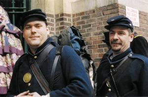 Kevin Ryan (left) and Kevin McCreedy (right) leave the 69th Regiment Armory to take the subway uptown to the St. Patrick's Day Parade. Ryan was in the film Gods and Generals. McCreedy is the only member of the brigade born in Ireland (Armagh).