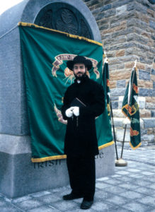 Robert Carter reenacts the roll of chaplain at the 1997 dedication of the monument to the Irish Brigade at Antietam. The uniform, down to the hat, which he had custom made, is based on his research of original photographs.