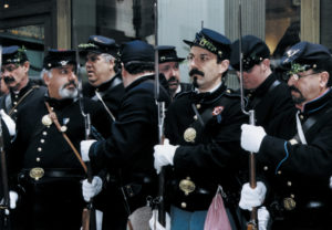 The Irish Brigade reenactors lining up outside Grand Central Station, put on their gloves and get ready to join The St. Patrick's Day Parade.